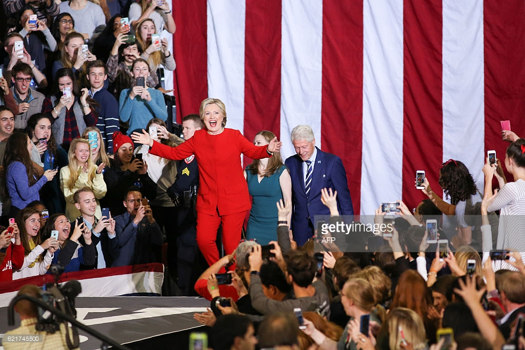 the-clinton-family-walks-on-stage-inside-the-reynolds-coliseum-on-the-picture-id621745500.jpg